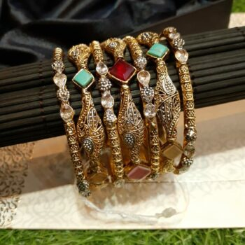 Emerald-gold-bangle-set